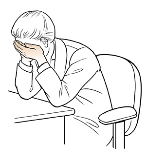 Woman sitting at desk doing eye cup exercise.
